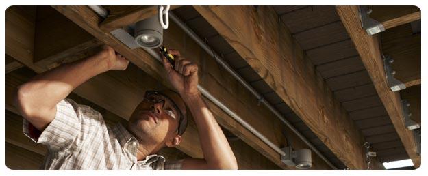 Attaboy Littleton electrician fixing a light fixture.